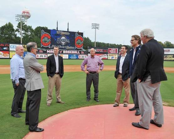 Representatives of the Milwaukee Brewers talk with Carolina Mudcats President and Majority Owner Steve Bryant (at far right), Mudcats Vice President and General Manager Joe Kremer (center) and General Manager of Operations Eric Gardner (second from left) on the field at Five County Stadium. Carolina Mudcats Photo by Nikolaus Johnson Carolina Mudcats Photo by Nikolaus Johnson